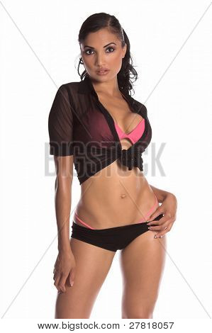 Sexy brunette Go Go dancer in black boy shorts, sheer top and pink bra and panties