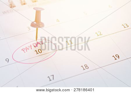 Business, Finance, Savings Money, Wages, Payroll Or Accounting Concept : Blue Thumbtack On Calendar