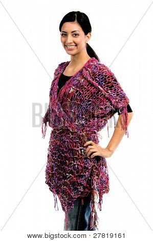 Right profile of a beautiful young Mexican woman in jeans and a black shirt and a purple couture feather wool shawl of