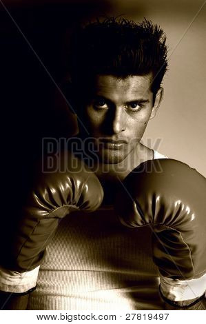 Young undiscovered boxer in a raw and gritty sepia tone