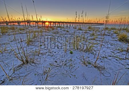 The Pensacola Beach Gulf Pier At Sunrise; Pensacola Beach, Florida