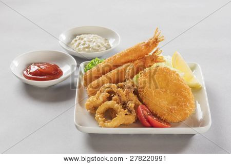 Japanese Fried Pork And Tempura In A Small White Dish