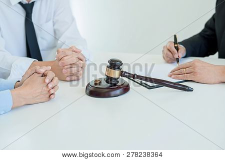 Judge Gavel With Justice Lawyers Deciding, Consultation On Marriage Divorce Between Married Couple A