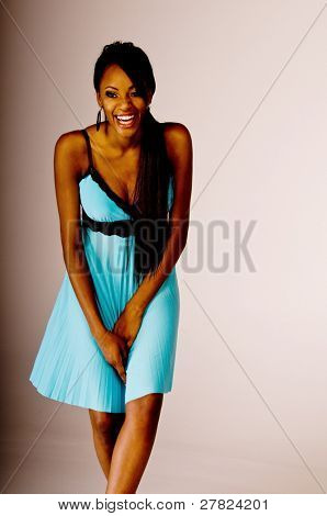 Beautiful young black woman at a party wearing a blue dress