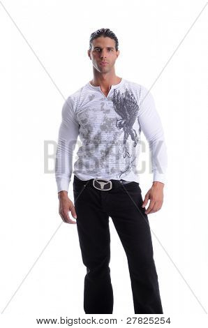 Muscular young man standing in black jeans and a white long sleeve t-shirt