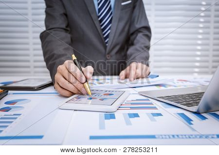 Business Man Looking At Business Document In Touchpad