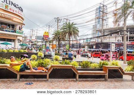 Patong, Thailand - 9th August 2018: Man Relaxing On A Bench Outside The Jung Ceylon Shopping Mall.