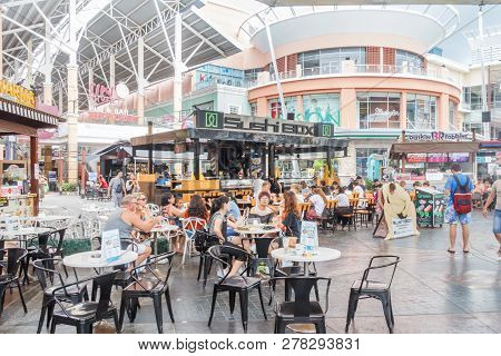 Patong, Thailand - 9th August 2018: People Sat Outisde The Sushi Box Restaurant In Jung Ceylon Shopp