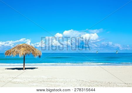 Straw Umbrella On Empty Seaside Beach In Varadero, Cuba. Amazing Blue Sky With Clouds. Relaxation, V