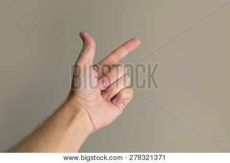 Gesture Hand Points To The Object. Download Stock Photo.