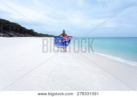 Aussie Girl Walking Along Beach Holding Australian Flag.  Australia Day, Australian Tourism, Vacatio