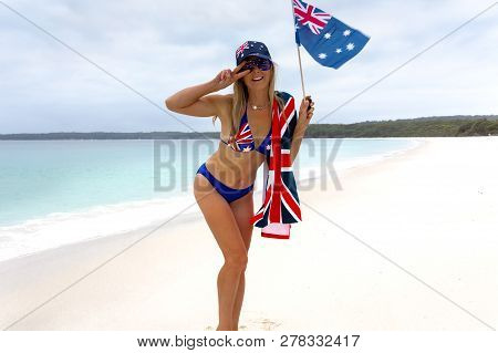 Happy Woman Wearing Australian Flag Printed On Her Bikini Hat And Sunglasses In A Patriotic Way, Hol