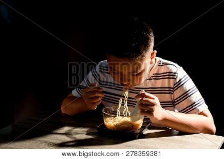 Young Asaian Boy Eat Instant Noodle