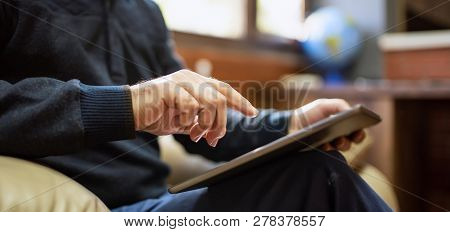 Man Having Rest In Office And Using His Digital Tablet