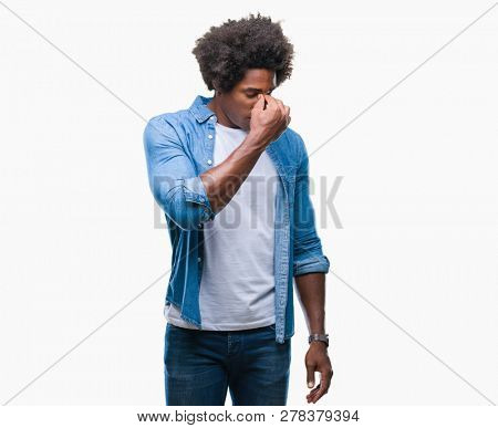 Afro american man over isolated background tired rubbing nose and eyes feeling fatigue and headache. Stress and frustration concept.