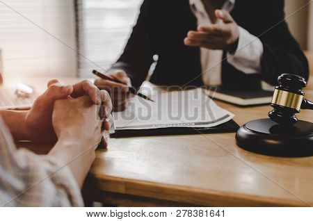 Legal Consultants, Notary Or Justice Lawyer Discussing Contract Document With Customer And Wooden Ju