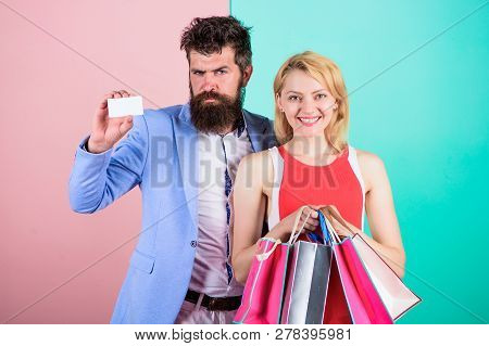 Couple Enjoy Shopping. Man Bearded Hipster Hold Credit Card And Girl Enjoy Shopping. Ask Man To Purc