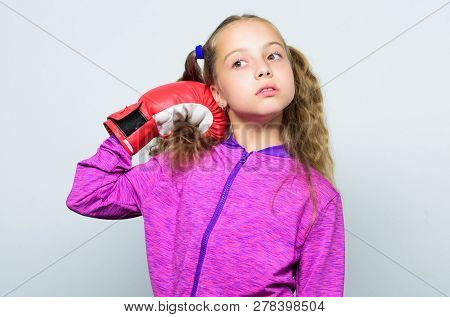 Sport Upbringing. Skill Of Successful Leader. Girl Cute Child With Red Gloves Posing On White Backgr