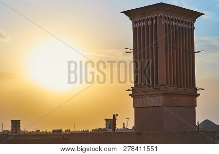 The Beautiful Sunset Over Adobe Badgirs (windcatchers) Of Yazd, Famous For Its Preserved Traditional
