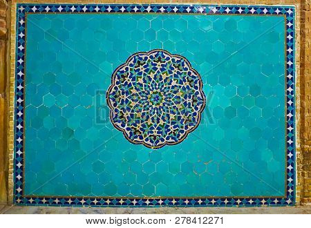 Bright Blue Decorative Panel On Wall Of Jameh Mosque With Ornate Mosaic Rossette In The Middle Of Az