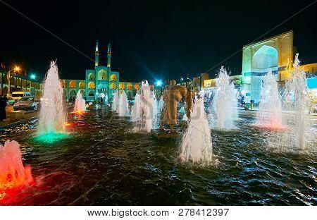 Enjoy The Bright Lights In Fountain, Decorating Evening Amir Chakhmaq Square, Yazd, Iran.