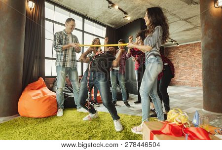 Friends Partying, Having Fun Playing Limbo Game