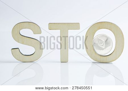 Security Token Offering Sto Sign With Wooden Letters And Silver Ethereum Coin Behind, Ethereum Conce