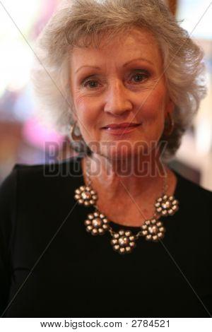 Mature Woman Wearing Silver Jewelry