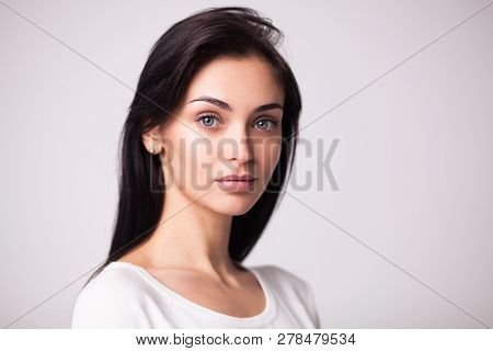 Closeup Studio Portrait Of Beautiful Brunette Woman Isolated On White Background