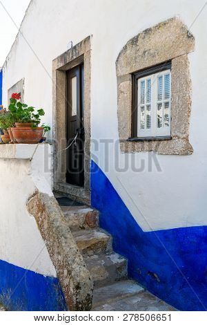 Traditional Architecture Of Old European Town. Narrow Street Of The Ancient Town. Scenic Old Town Wi
