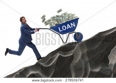 Businessman pushing wheelbarrow uphill in debt loan concept