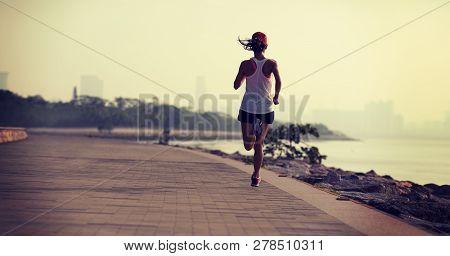 On Fitness Sportswoman Running On Sunny Coast