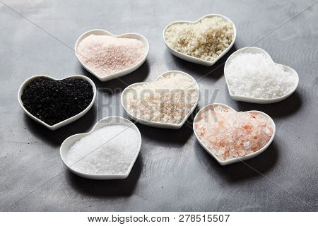 Variety Of Global Culinary Salts In Heart Bowls