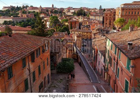PERUGIA, ITALY - AUGUST 15, 2018: Cityscape of Perugia with the medieval aqueduct. The approximately three km long aqueduct from Monte Pacciano to Piazza Grande was built in 1254