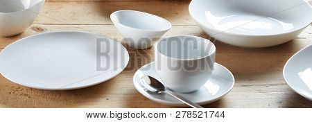 White Cup On Saucer And Ceramic Bowls