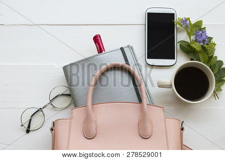 Notebook Planner ,mobile Phone ,coffee And Pink Hand Bag Of Lifestyle Working Woman For Business At