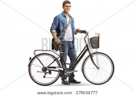Full length shot of a casual young man standing with a bicycle isolated on white background