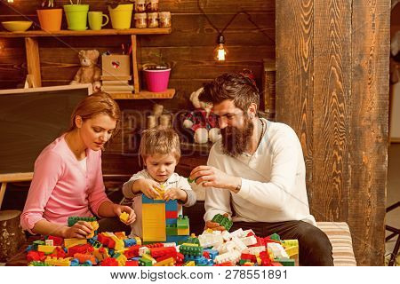 Family Concept. Family Play With Colorful Bricks. Family Build Structure With Toy Bricks. Family Lov