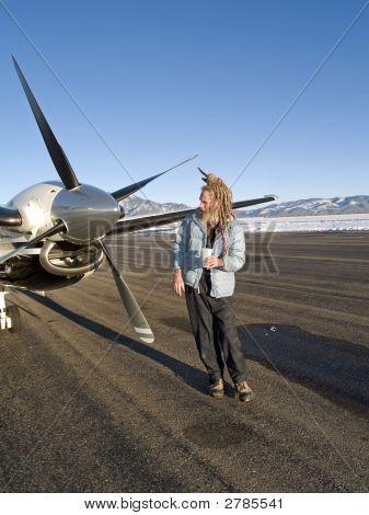 Eccentric Older Man By An Aircraft