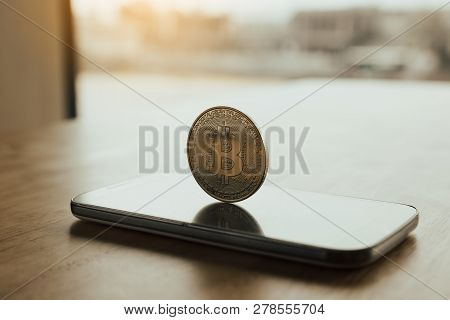Bitcoin Symbol On Smartphone Screen And Cryptography Concept.
