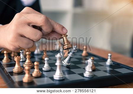 Businessman Playing Chess Game Beat Opponent With Strategy Concept.