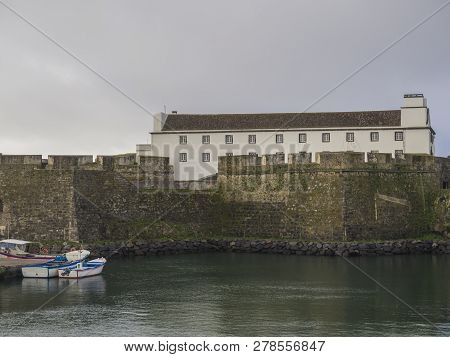 Forte De Sao Bras In Ponta Delgada View At Fishing Harbor And Boats With Historical Fortification Ne