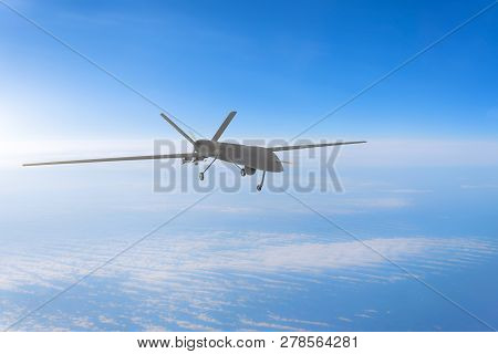 Unmanned military drone on patrol air at high altitude. poster