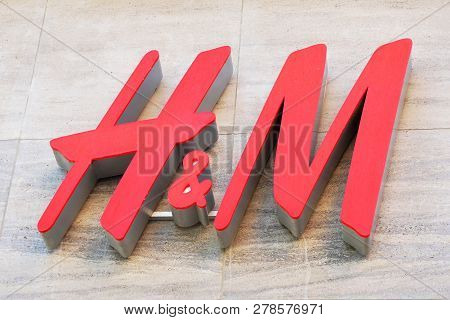 Hannover, Germany - May 8, 2018: H And M Logo Sign On Facade Of Local Fashion Chain Store Of Global