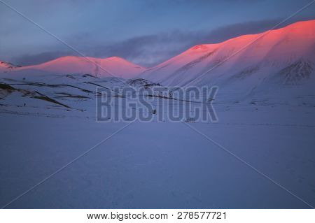 Alpenglow Phenomenon At The Sunset On The Peak Of Monte Vettore In Umbria, Italy
