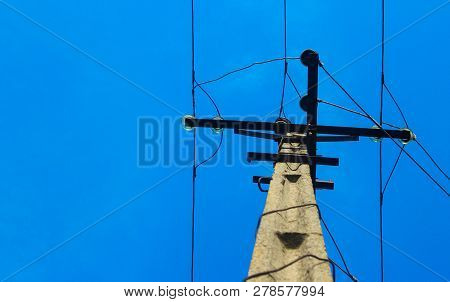Electricity Post In Blue Sky. Outdoor View. Electrical Powered Pillar. Power Lines - Power Transmiss