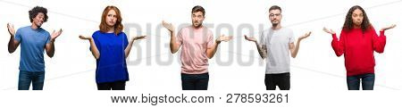 Composition of african american, hispanic and caucasian group of people over isolated white background clueless and confused expression with arms and hands raised. Doubt concept.