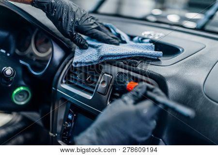 Auto detailing of car interior on carwash service
