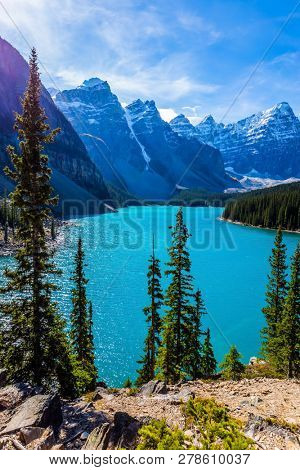 Park Banff, Canadian Rockies, Province of Alberta. Lake Moraine with emerald water in the Valley of the Ten Peaks. The concept of ecological, photographic and active tourism