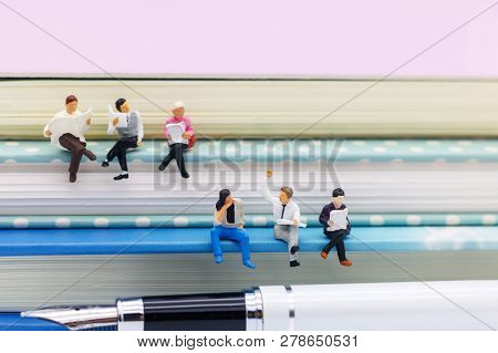 Miniature People: Business Team Reading Book, Education Or Business Concept.